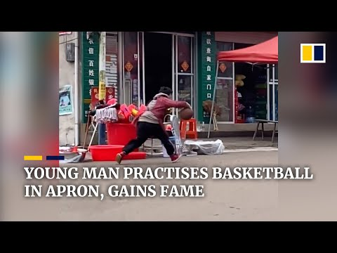 Young chinese man practises basketball in apron, gains online fame