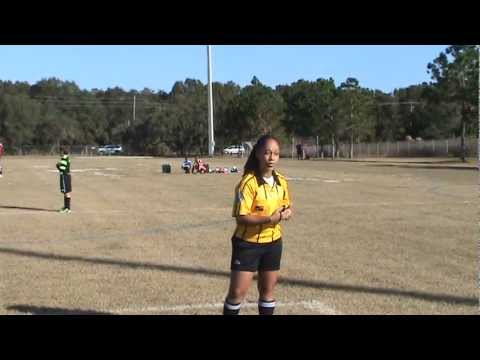 Soccer referee explains handball rule to parent in heated exchange